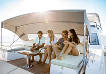 Group of friends lounging on yacht