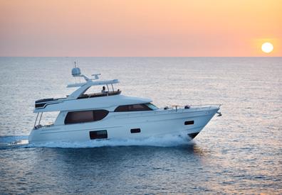beautiful sunset illuminates yacht making its way across horizon
