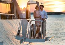 couple on yacht enjoying romantic sunset