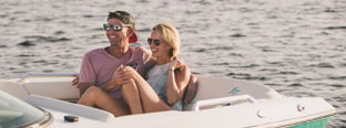 Man and women sitting at bow of boat