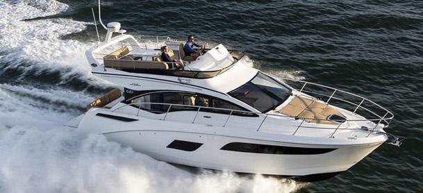 Yacht racing through ocean water