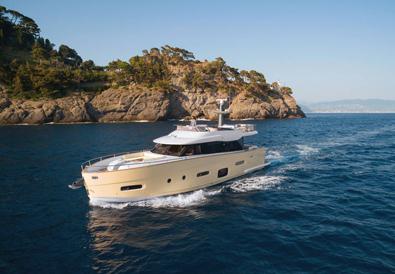 Yacht cruises through calm blue waters