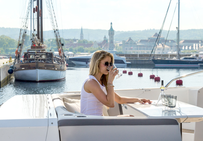 Woman on yacht enjoys drink