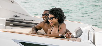 Couple on yacht smiling and laughing