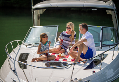 Family enjoys picnic on bow of boat
