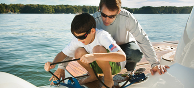Father teaching son boating knots