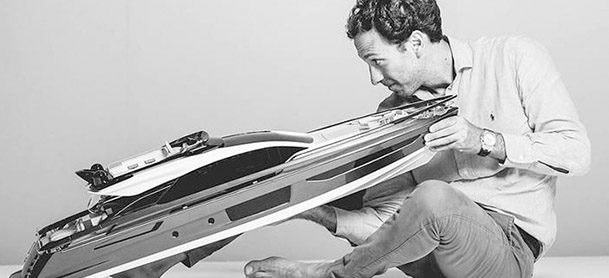 man holding and looking at model of the Azimut S10