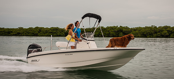 Couple and dog on Boston Whaler 170 Dauntless