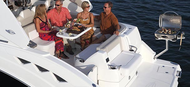 people eating on the aft deck of a boat