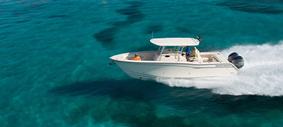 grady-white running over clear turquoise waters dotted with reefs beneath the surface