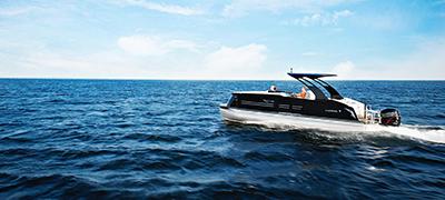 harris pontoon running over dark choppy open waters