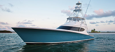 Hatteras GT63 in the water.