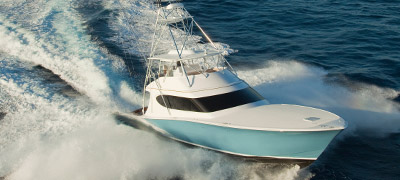 Hatteras GT70 cruising through the ocean.