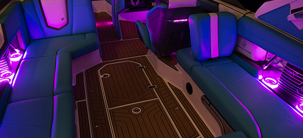 purple lights glowing on inside of boat