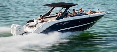 Family cruising on a MarineMax Sea Ray Sport Boat.