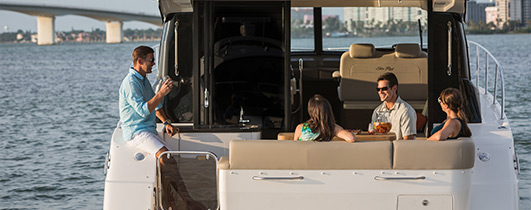 Sea Ray 470 Sundancer with people lounging on aft seating
