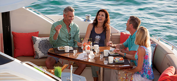 Couples enjoying a meal on a Sea Ray L590