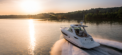 A Sea Ray Sundancer 350 cruising towards the sunset
