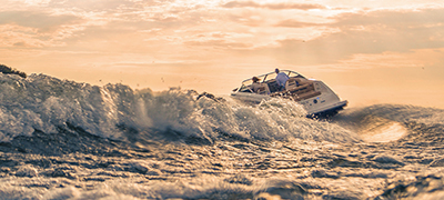Large wake behind a running boat at sunset