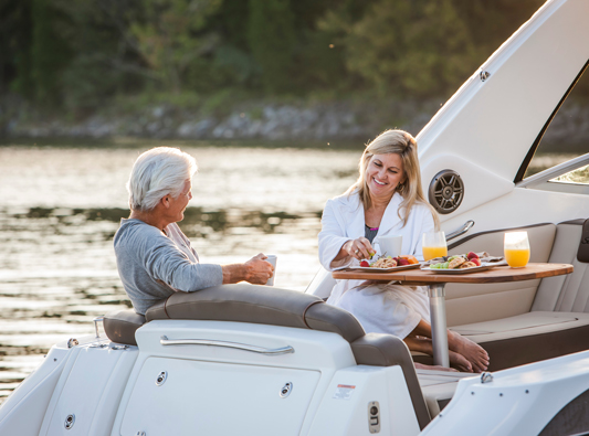 couple enjoys breakfast on boat
