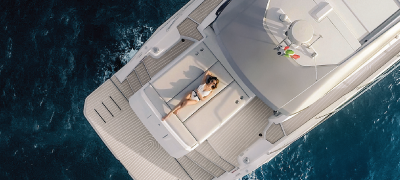 Exclusive sales event with a view of a woman lounging on a yacht in a water