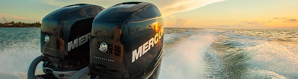 Mercury outboard engines with the sunset behind them