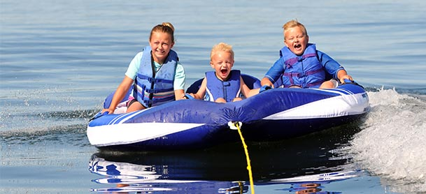 Three kids tubing