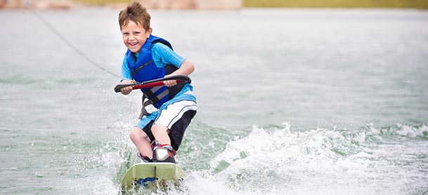 A boy wakeboarding