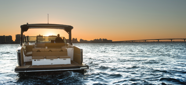 Aviara AV40 boat out on the water with a sunset view
