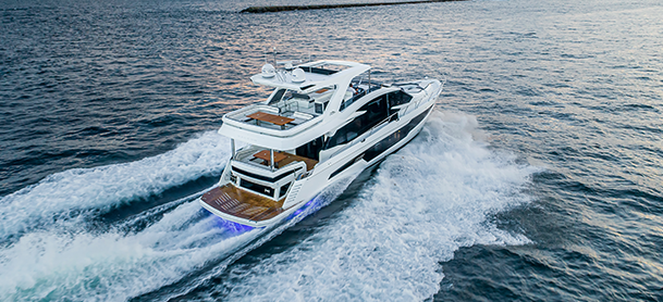 A Galeon 680 Fly cruising through open blue water