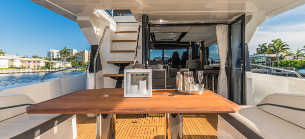 A view of a table, stairs, and interior of a Galeon 680 Fly