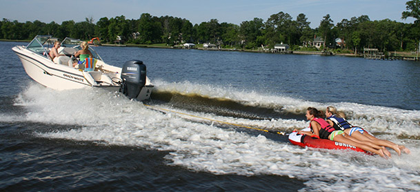 boat towing tubers