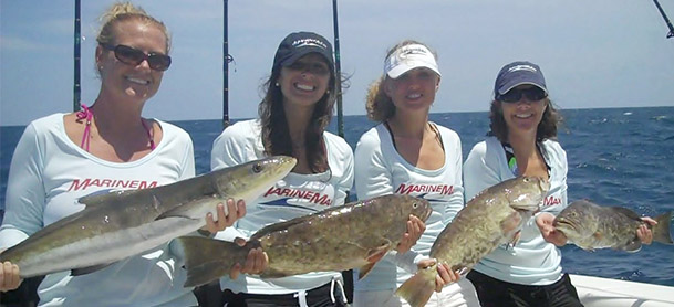 group of women holding fish