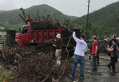 people picking up debris