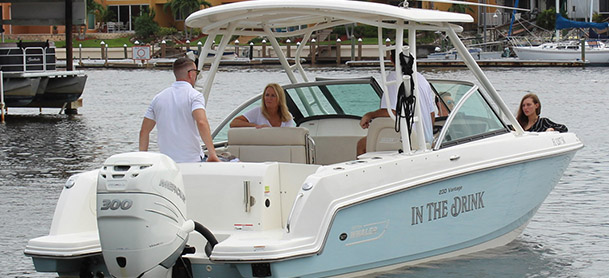 A family on a Boston Whaler 230 Vantage