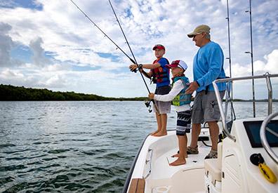 man and kids fishing