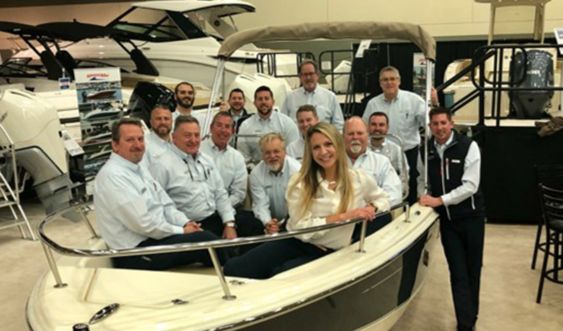 A group of MarineMax employees in a boat