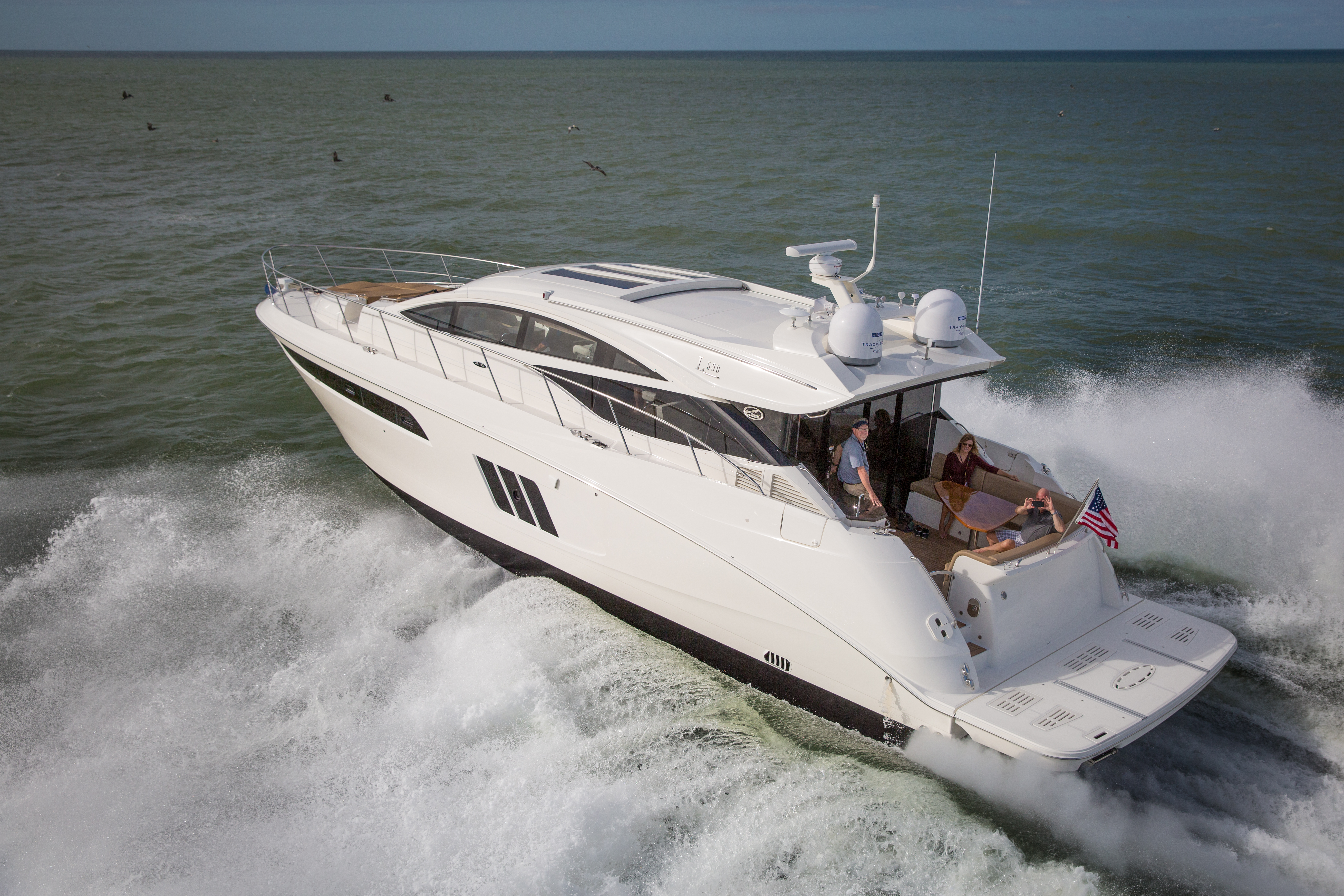 A cruising motor yacht out on the water traveling to the destination