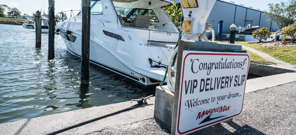 boat parked in the VIP Delivery Slip. A sign reads 'Welcome to your dream'