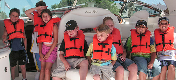 group of kids in life jackets