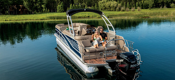 Couple relaxing on back of pontoon boat