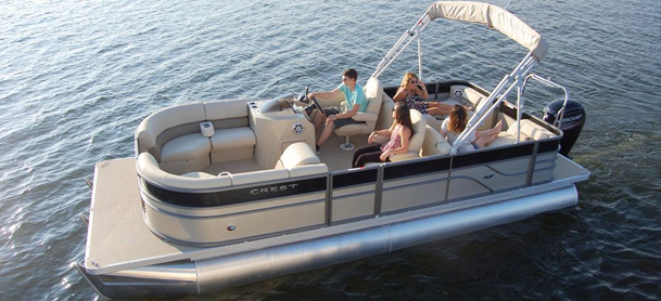 Group of people lounging in a pontoon boat out on the water