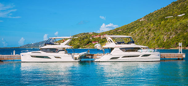 Two MarineMax Vacations power catamarans docked in the British Virgin Islands