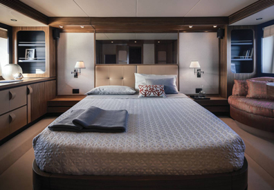 luxurious master bedroom of interior cabin of yacht