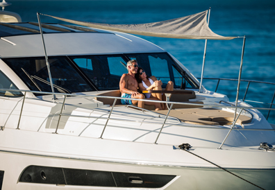 Happy couple relaxes on yacht