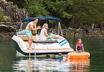 family on small sport boat
