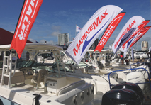 row of boats lined with marinemax banners