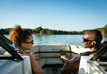 couple on sport boat