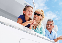 family on a yacht looking out over water