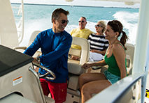 two couples aboard a boat cruising through water